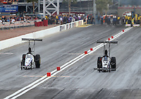 Apr 10, 2015; Las Vegas, NV, USA; NHRA top alcohol dragster driver Bill Litton (right) races alongside XXXX during qualifying for the Summitracing.com Nationals at The Strip at Las Vegas Motor Speedway. Mandatory Credit: Mark J. Rebilas-