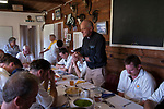 Ebernoe Horn Fair, Sussex 2017. The two teams about to eat a traditional lamb Roast, prayers are said before the team lunch.