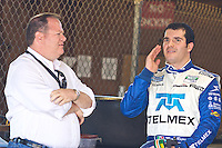 Memo Rojas, right, talks with is car owner Chip Ganassi after winning the pole position for the EMCO Gears Classic Grand-American Sports Car race at Mid-Ohio Sports Car Course in Lexington, Ohio on Friday, June 18, 2010. (Photo by Brian Cleary/www.bcpix.com