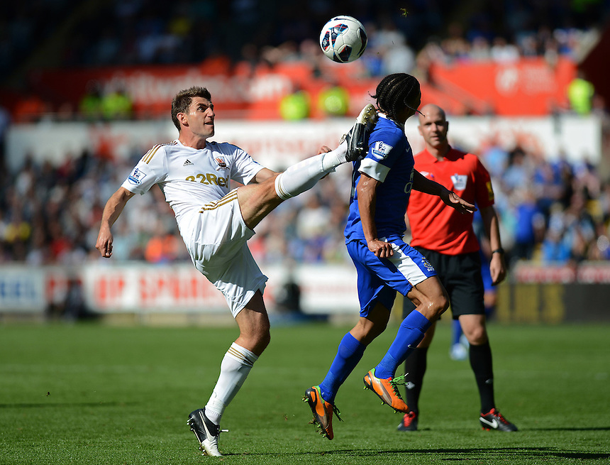 Swansea City's Angel Rangel nearly takes out Everton's Steven Pienaar with the high kick..Football - Barclays Premiership - Swansea City v Everton - Saturday 22nd September 2012 - Liberty Stadium - Swansea..