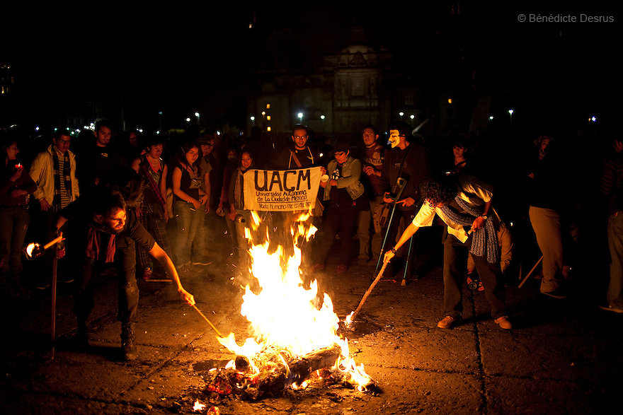 "30 June 2012 - Mexico City, Mexico - University students members of the movement ?yo soy 132? (I am 132) make a fire during a peaceful demonstration to demand transparency in the next election at Zocalo square in Mexico City. ""YoSoy132"" movement was organized by students against the candidature of Enrique Pena Nieto, presidential candidate of the opposition Institutional Revolutionary Party (PRI), who also demanded a balance in the media coverage of the presidential race. Mexico's presidential elections will take place on July 1. Photo credit: Benedicte Desrus"