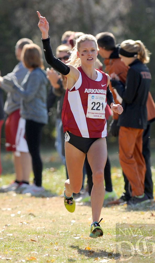 NWA Media/ANDY SHUPE - Arkansas' Dominique Scott (221) celebrates  in the final straight during the NCAA Cross Country South Central Regional Friday, Nov. 14, 2014, at Agri Park in Fayetteville.