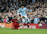 Manchester City's Leroy Sane is tackled by Liverpool's Dejan Lovren<br /> <br /> Photographer Rich Linley/CameraSport<br /> <br /> UEFA Champions League Quarter-Final Second Leg - Manchester City v Liverpool - Tuesday 10th April 2018 - The Etihad - Manchester<br />  <br /> World Copyright &copy; 2017 CameraSport. All rights reserved. 43 Linden Ave. Countesthorpe. Leicester. England. LE8 5PG - Tel: +44 (0) 116 277 4147 - admin@camerasport.com - www.camerasport.com