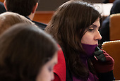 A reporter wearing a jacket, scarf and gloves due to the cold room, attends the United States House Judiciary Committee hearing on the impeachment of US President Donald Trump on Capitol Hill in Washington, DC, December 4, 2019.<br /> Credit: Saul Loeb / Pool via CNP