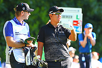 Byeong Hun An discuss his tee shot with his caddy, on the 2nd tee during the BMW PGA Golf Championship at Wentworth Golf Course, Wentworth Drive, Virginia Water, England on 26 May 2017. Photo by Steve McCarthy/PRiME Media Images.