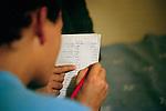 [English] Informal french lesson at the hotel. Like every child in France, isolated foreign minors who are less than 16 should be sent to school. Between 16 and 18, they have very few choices and try to start a semi-professional education but they need a working permit, which is almost impossible to obtain. <br /> <br /> [Francais] Cours de fran&ccedil;ais informel a l'h&ocirc;tel. Comme tous enfants sur le sol fran&ccedil;ais, les mineurs isoles etrangers de moins de 16 ans qui reussissent a &ecirc;tre pris en charge doivent &ecirc;tre scolarises. Du fait de leur parcours, ces enfants sont en situation de rupture scolaire et un enseignement adapte leur est propose. Au dela de 16 ans, peu de places sont disponibles pour eux. Souhaitant s'orienter vers des formations semi-professionnelles, il essuient souvent un refus de se voir delivrer une autorisation de travail par la Direction Departementale du Travail.
