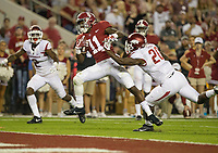Hawgs Illustrated/BEN GOFF <br /> Henry Ruggs (11), Alabama reciever, evades the grasp of DeAndre Coley (20), Arkansas free safety, to score a touchdown in the third quarter Saturday, Oct. 14, 2017, at Bryant-Denny Stadium in Tuscaloosa, Ala.