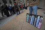 A vendor sells Barack Obama pins as thousands line up to see Barack Obama on his whistle stop tour in Baltimore, Maryland on January 17, 2008.