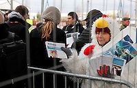 A woman hands out information. United Nations Climate Change Conference (COP15) was held at Bella Center in Copenhagen from the 7th to the 18th of December, 2009. A great deal of groups tried to voice their opinion and promote their cause in various ways. .©Fredrik Naumann/Felix Features.
