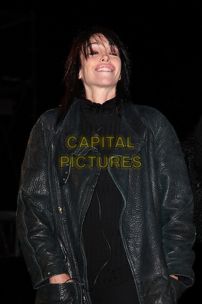 HEIDI FLEISS .Contestants enter the House on the Opening Night of Celebrity Big Brother, Elstree Studios, London, England, UK, .January 3rd 2010.CBB BB half length coat jacket hands in pockets  black smiling leather  .CAP/ROS.©Steve Ross/Capital Pictures