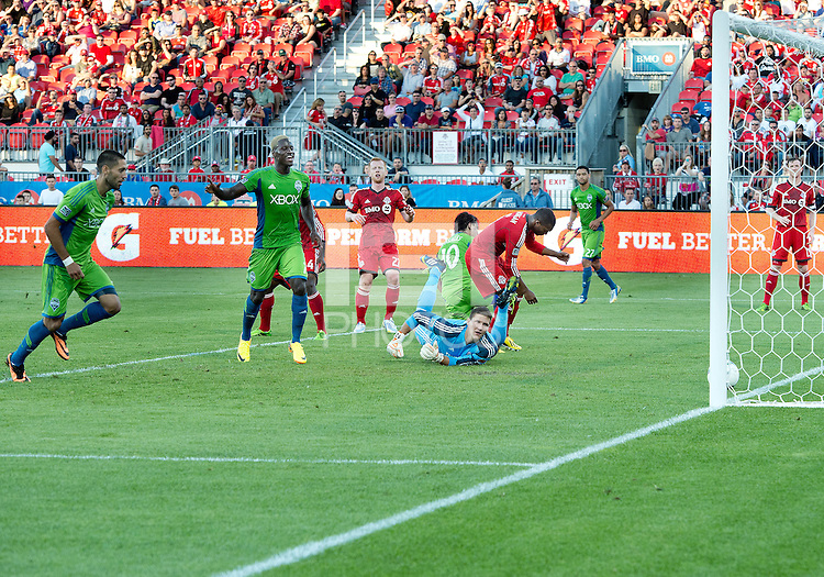 August 10, 2013: Toronto FC goalkeeper Joe Bendik #12 watches as a ball rolls into the net on an own goal by Toronto FC defender Doneil Henry #4 as Seattle Sounders FC forward Clint Dempsey #2 and Seattle Sounders FC forward Eddie Johnson #7 celebrate during an MLS regular season game between the Seattle Sounders and Toronto FC at BMO Field in Toronto, Ontario Canada.<br /> Seattle Sounders FC won 2-1.