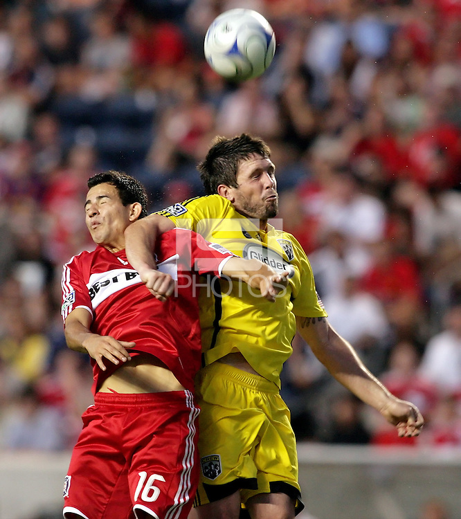 Chicago Fire midfielder Marco Pappa (16) battles for a header with Columbus Crew midfielder Danny O'Rourke (5).  The Chicago Fire tied the Columbus Crew 0-0 at Toyota Park in Bridgeview, IL on July 11, 2009.