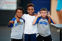 Three young fans pose for a photo during a Bluefield Blue Jays game against the Bristol Pirates on July 26, 2018 at Bowen Field in Bluefield, Virginia.  Bristol defeated Bluefield 7-6.  (Mike Janes/Four Seam Images)