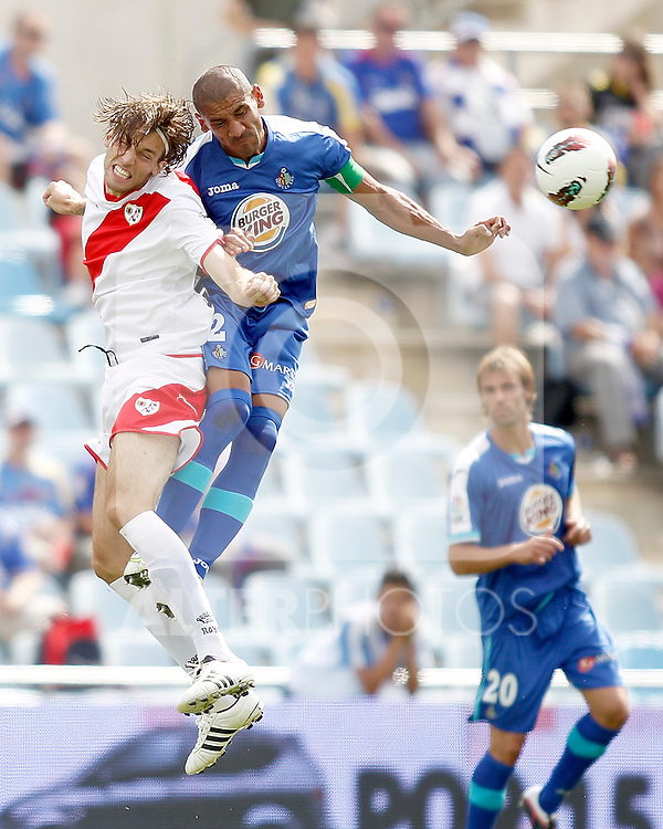 Getafe's Daniel Cata Diaz against Rayo Vallecano's Miguel Perez Michu during La Liga Match. September 18, 2011. (ALTERPHOTOS/Alvaro Hernandez)