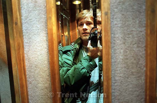 Trent Nelson in mirror with camera in elevator<br />