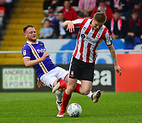 Lincoln City's Scott Wharton vies for possession with Exeter City's Jake Taylor<br /> <br /> Photographer Andrew Vaughan/CameraSport<br /> <br /> The EFL Sky Bet League Two Play Off First Leg - Lincoln City v Exeter City - Saturday 12th May 2018 - Sincil Bank - Lincoln<br /> <br /> World Copyright &copy; 2018 CameraSport. All rights reserved. 43 Linden Ave. Countesthorpe. Leicester. England. LE8 5PG - Tel: +44 (0) 116 277 4147 - admin@camerasport.com - www.camerasport.com