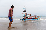 13 February 2019,Pelabuhan Ratu,Sukabumi Regency, West Java, Indonesia. Forty eight year old fisherman, Darji, helps launch a fishing boat from the beach at Cibangban village in West Java. He has a police conviction for transporting Afghan refugees to boats bound for Australia. He says that people smugglers have not been active in the area for a long time in the wake of the Australian Government's concern that boats will once again start trafficking people to Australia with the new Medical legislation that has been passed. Picture by Graham Crouch/The Australian