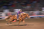 WY: Wyoming, Cody..Cody Night Rodeo..Photo #: yellow930.Photo copyright Lee Foster, 510/549-2202, lee@fostertravel.com, www.fostertravel.com..