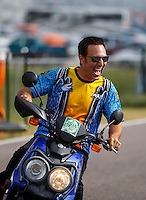 Sep 25, 2016; Madison, IL, USA; Crew member for NHRA pro stock motorcycle rider Jerry Savoie celebrates after winning the Midwest Nationals at Gateway Motorsports Park. Mandatory Credit: Mark J. Rebilas-USA TODAY Sports