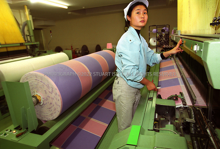 Packing towels at one of the 220 towel makers in and around the quaint little city of Imabari on the island of Shikoku, Japan. Together, they produce nearly two-thirds of the towels made in the country. But cheap imports from China and elsewhere in Asia are soaking up orders, growing by a third in the past two years to take 60% of the market...This is the underside of the commercial juggernaut that only a decade ago terrified global competitors. The real Japan Inc. is dominated by small and medium-sized businesses ? factories that supply the behemoths or produce goods for the domestic market, construction firms that pave local roads, retailers that serve neighborhood shoppers. They employ 78% of the workforce, and they've never felt the full wrath of market forces ? until now.