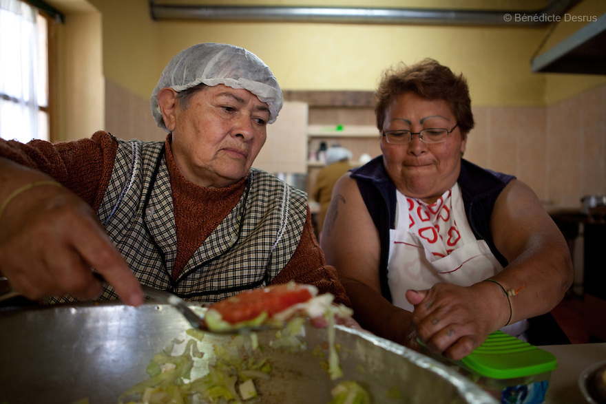 Laeticia (L) and Paola (R) serve lunch to the residents of Casa Xochiquetzal in Mexico City, Mexico on October 4, 2010. Casa Xochiquetzal is a shelter for elderly sex workers in Mexico City. It gives the women refuge, food, health services, a space to learn about their human rights and courses to help them rediscover their self-confidence and deal with traumatic aspects of their lives. Casa Xochiquetzal provides a space to age with dignity for a group of vulnerable women who are often invisible to society at large. It is the only such shelter existing in Latin America. Photo by Bénédicte Desrus