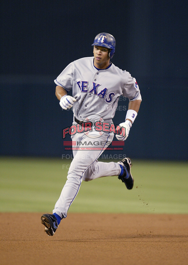 Alex Rodriguez of the Texas Rangers runs the bases during a 2002 MLB season game against the Los Angeles Angels at Angel Stadium, in Los Angeles, California. (Larry Goren/Four Seam Images)
