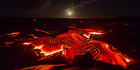 Moonlit Lava Landscape: Large amounts of lava flow slowly as the moon rises and lights up the 61g flow at night, Hawai'i Volcanoes National Park, Big Island.