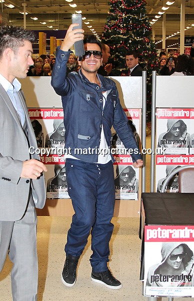 """NON-EXCLUSIVE PICTURE: MATRIXPICTURES.CO.UK.PLEASE CREDIT ALL USES..WORLD RIGHTS..Australian pop singer Peter Andre is pictured signing copies of his new album """"Angels And Demons"""" at Manchester's Ellesmere Shopping Centre...OCTOBER 31st 2012..REF: MMY 124993"""