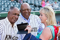 Minnie Mendoza (left) and Tony Oliva (center) look at a photo that was taken by Lisa Crockett-Moon (right) prior to the International League game between the Durham Bulls and the Charlotte Knights at BB&T BallPark on May 16, 2017 in Charlotte, North Carolina.  The Knights defeated the Bulls 5-3. (Brian Westerholt/Four Seam Images)