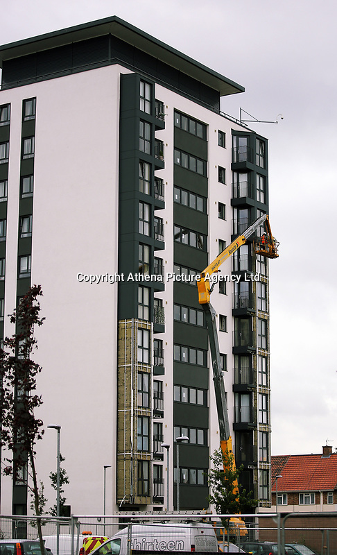 Pictured: Workers on a cherry picker remove cladding panels from Kennedy Gardens flats in Billingham. Tuesday 27 June 2017<br />Re: Cladding is being removed by workers from the fascia of high-rise flats at Kennedy Gardens in Billingham, County Durham, England, UK