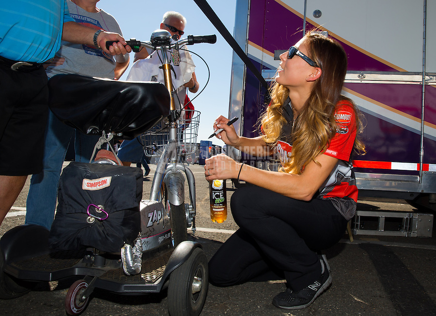Feb 6, 2015; Pomona, CA, USA; NHRA top fuel driver Leah Pritchett signing autographs for her fans during qualifying for the Winternationals at Auto Club Raceway at Pomona. Mandatory Credit: Mark J. Rebilas-