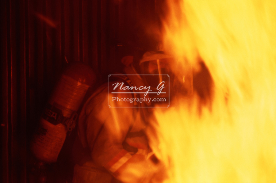 Fire fighter in a room of fire