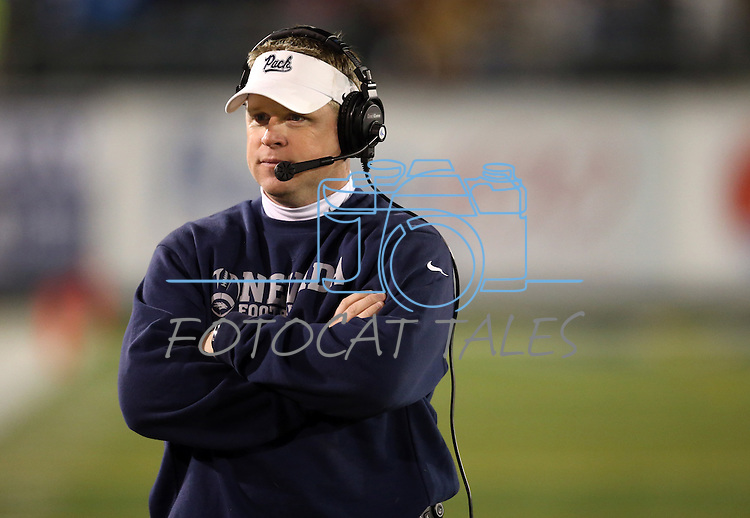 Nevada Head Coach Brian Polian works in an NCAA college football game against San Jose State, in Reno, Nev., on Saturday, Nov. 16, 2013. (AP Photo/Cathleen Allison)