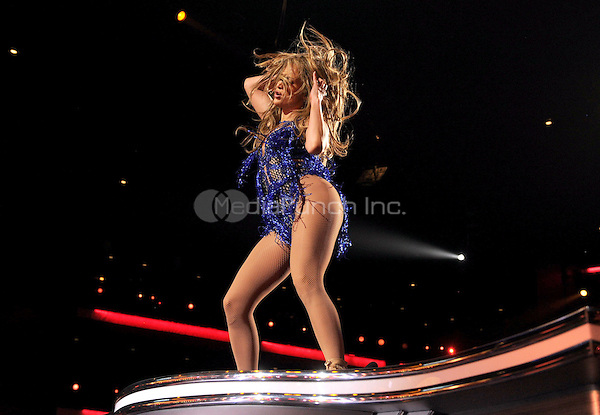 "LOS ANGELES, CA - MAY 21 : Judge Jennifer Lopez performs onstage at FOX's ""American Idol XIII"" finale at Nokia Theatre L.A. Live on May 21, 2014 in Los Angeles, California. Credit: PGMicelotta/MediaPunch"