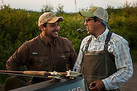 150620-JRE-7981E-0312 Cal Trout, left, and Joshua Quong, right, both teachers and quail hunting guides from Mississippi, celebrate at the truck after a day on an interior Alaska stream fishing for Arctic Grayling.