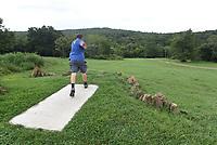 NWA Democrat-Gazette/FLIP PUTTHOFF <br /> Brian Richardson plays a scenic hole at his disc golf course.