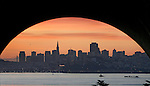 """Planet San Francisco,"" a break in the foul weather as the city takes on another look of crisp clear blue skies.  An arch tunnel on Bunker Road leading into Fort Baker helped San Francisco skyline at day break take on worldly appearance. .."