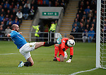 Kris Boyd throws himself at the ball