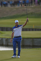 Alex Noran (Team Europe) celebrates sinking his long birdie putt on 18 to ice the cake on a Team Europe win following  Sunday's singles of the 2018 Ryder Cup, Le Golf National, Guyancourt, France. 9/30/2018.<br /> Picture: Golffile | Ken Murray<br /> <br /> <br /> All photo usage must carry mandatory copyright credit (&copy; Golffile | Ken Murray)