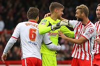 Stevenage Goalkeeper Jesse Joronen is congratulated by his team mates after opening the scoring  during the Sky Bet League 2 match between Stevenage and Wycombe Wanderers at the Lamex Stadium, Stevenage, England on 17 October 2015. Photo by PRiME Media Images.