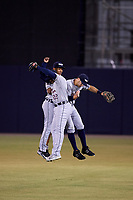 Lakeland Flying Tigers left fielder Quincy Latimore (22), center fielder Jose Azocar and right fielder Ross Kivett celebrate after the final out of a game against the Tampa Yankees on April 7, 2017 at George M. Steinbrenner Field in Tampa, Florida.  Lakeland defeated Tampa 5-0.  (Mike Janes/Four Seam Images)