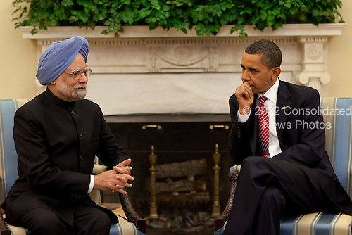 Washington, DC - November 24, 2009 -- United States President Barack Obama talks with Prime Minister Manmohan Singh in the Oval Office during the Prime Minister's state visit to the White House, November 24, 2009..Mandatory Credit: Pete Souza - White House via CNP