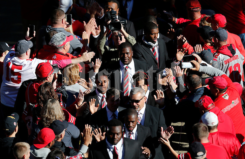 Ohio State Buckeyes quarterback Cardale Jones (12) high fives fans as he heads to Ohio Stadium with the team before the college football game between the Ohio State Buckeyes and the Maryland Terrapins in Columbus, Saturday afternoon, October 10, 2015. (The Columbus Dispatch / Eamon Queeney)