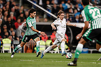 2nd November 2019; Estadio Santiago Bernabeu, Madrid, Spain; La Liga Football, Real Madrid versus Real Betis; Luka Modric (Real Madrid)  controls the ball as he outpaces Bartra of Betis - Editorial Use