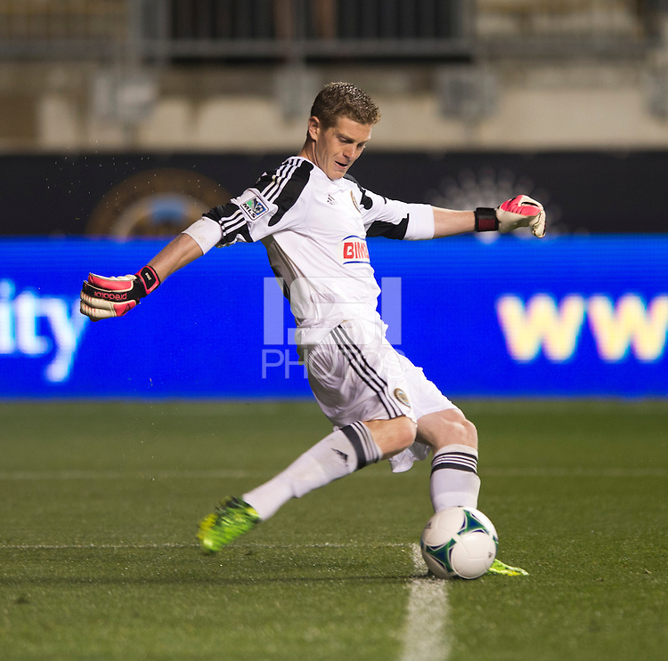 Zac MacMath (18) of the Philadelphia Union punts the ball downfield during a Major League Soccer match at PPL Park in Chester, PA.  Philadelphia defeated Chicago, 1-0.