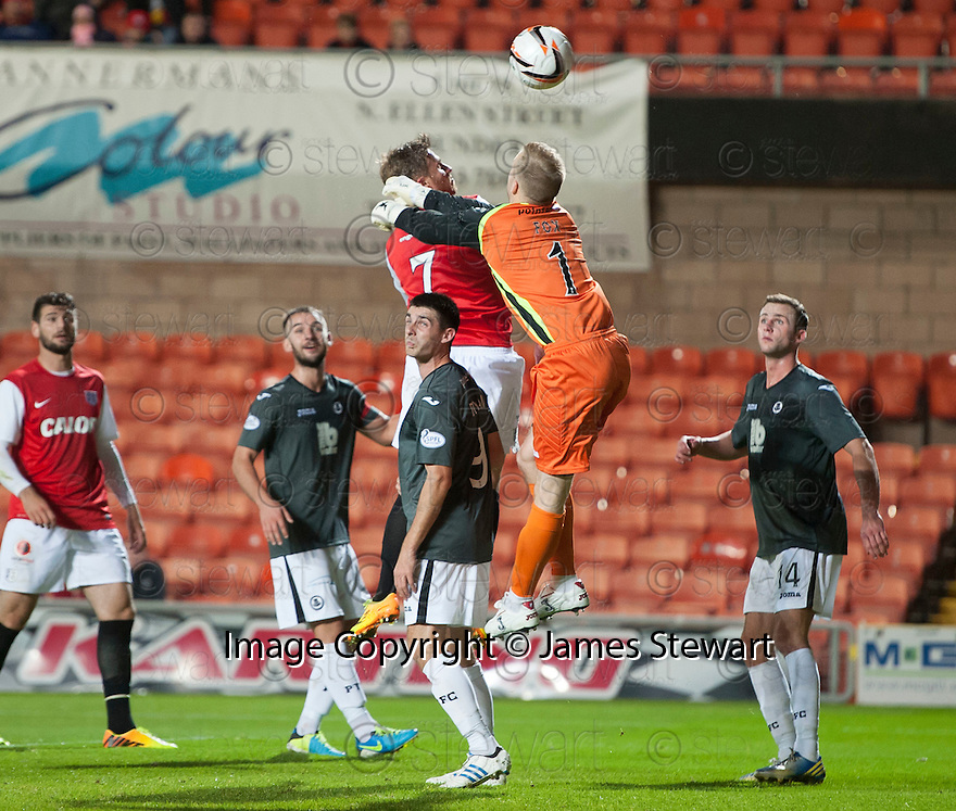 Dundee Utd's David Goodwillie (7) gets to the ball in front of Partick goalkeeper Scott Fox to head home their second goal.