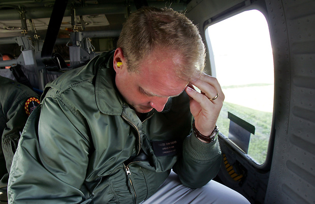 Iowa Gov. Chet Culver bows his head after landing in Iowa City following a tour of the flooded regions of the state Tuesday, June 10, 2008.