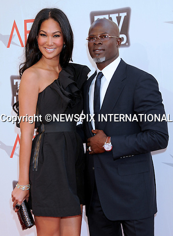 "DJIMON HOUNSOU AND KIMORA SIMMONS.attends TV Land Presents: The AFI Life Achievement Awards Honoring Morgan Freeman at Sony Pictures Studios, Culver City, California_9 June 2011.Mandatory Photo Credit: ©Crosby/Newspix International. .**ALL FEES PAYABLE TO: ""NEWSPIX INTERNATIONAL""**..PHOTO CREDIT MANDATORY!!: NEWSPIX INTERNATIONAL(Failure to credit will incur a surcharge of 100% of reproduction fees)..IMMEDIATE CONFIRMATION OF USAGE REQUIRED:.Newspix International, 31 Chinnery Hill, Bishop's Stortford, ENGLAND CM23 3PS.Tel:+441279 324672  ; Fax: +441279656877.Mobile:  0777568 1153.e-mail: info@newspixinternational.co.uk"
