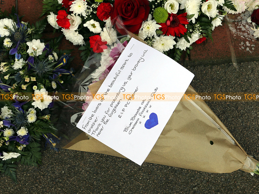 A floral display to Charlton fan, PC Palmer. Supporters have been invited to lay flowers or other tributes and stand together against acts of terror and to remember all those who have been affected by the incident in Westminster during Charlton Athletic vs MK Dons, Sky Bet EFL League 1 Football at The Valley on 4th April 2017