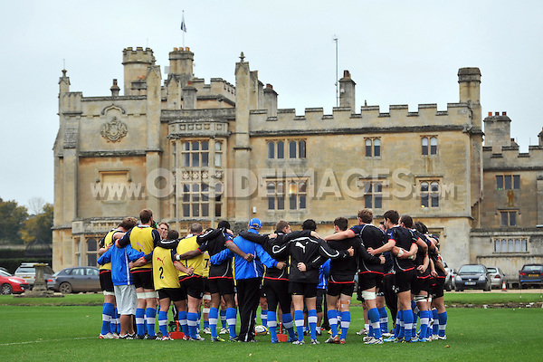 Players and coaches huddle together at the end of the session. Bath Rugby training session on October 25, 2012 at Farleigh House in Bath, England. Photo by: Patrick Khachfe/Onside Images